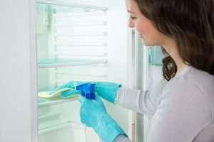 Woman Cleaning Fridge