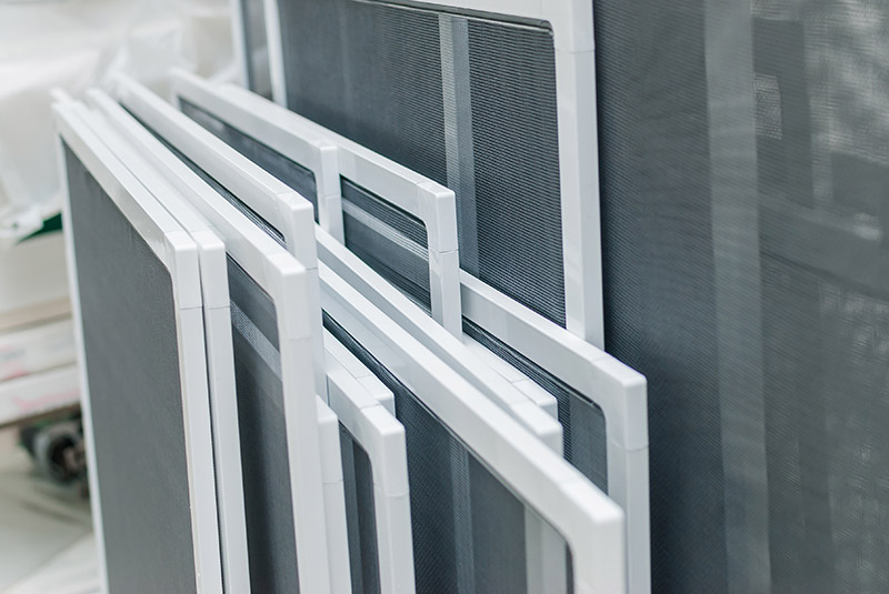 a stack of window screens