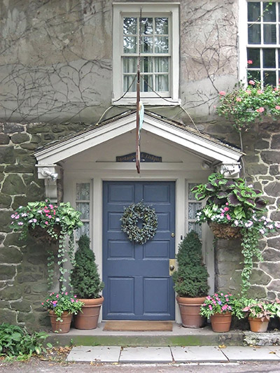 blue entry door with a wreath