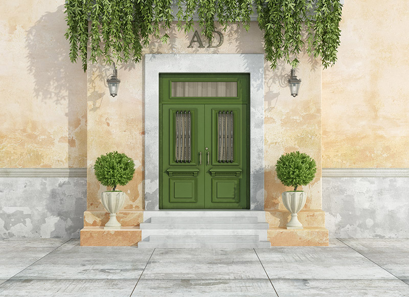 green entry door with a transom