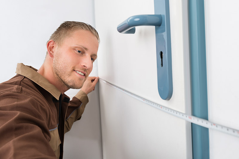 a guy measuring his door