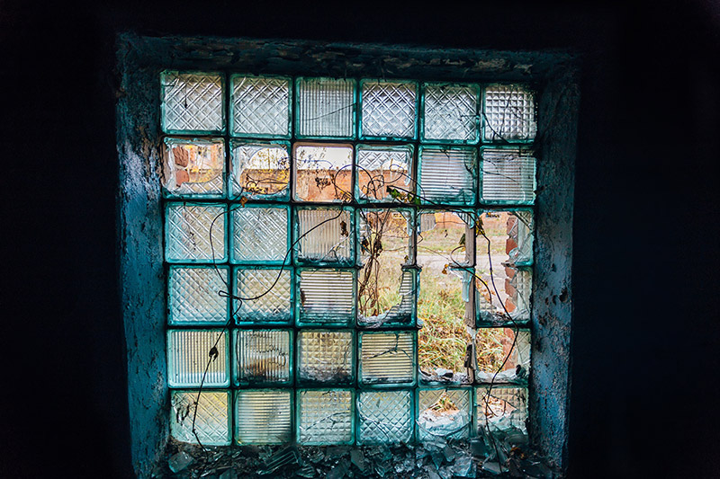 broken glass block window